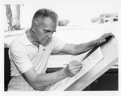 Jack Kirby at the drawing board (image from heroinitiative.org)