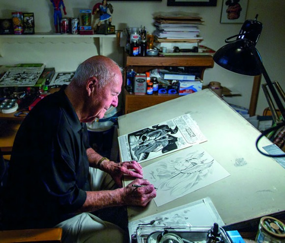 Joe Sinnott at his drawing board